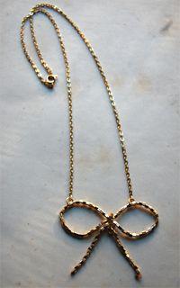 hacer un collar en forma de moño